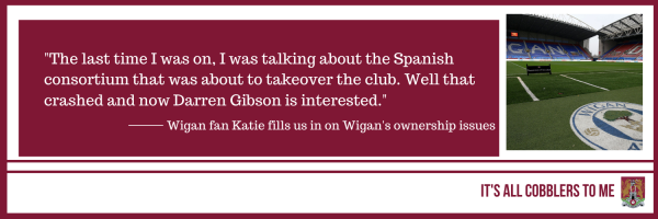 text to the left of a picture of the DW Stadium, Wigan